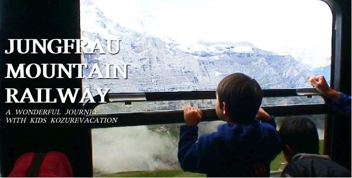 登山鉄道の窓に乗り出して景色を見るリュウ